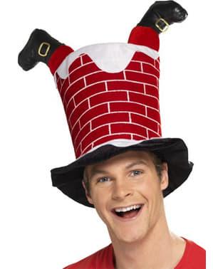Klobouk Santa Claus zaseklý v komíně