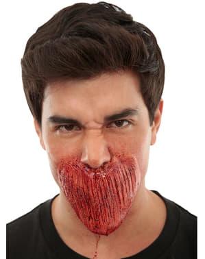 Cicatriz de boca cosida tipo zombie