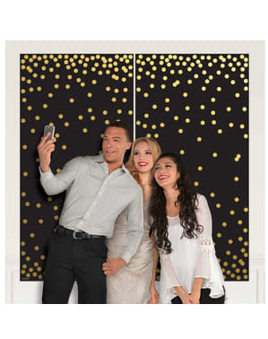 Black photocall sign with gold polka dots