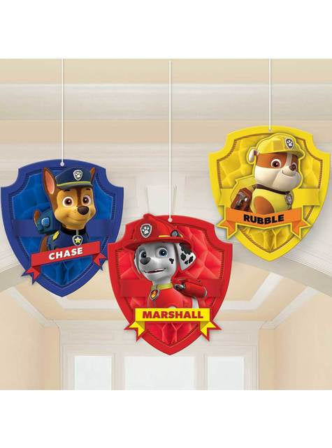 3 dolls hanging from Paw Patrol panel