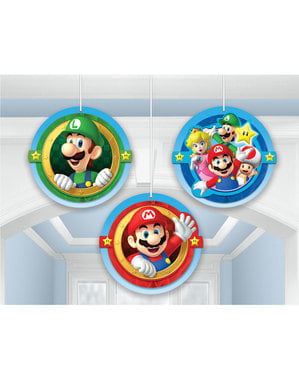 3 Super Mario Bros decorations hanging from honeycomb paper