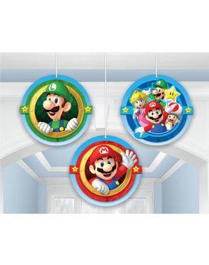 Sett med 3 Super Mario Bros dekorasjoner hengende fra honeycomb papir