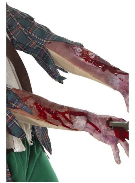 Lateksinen käsi haavalla