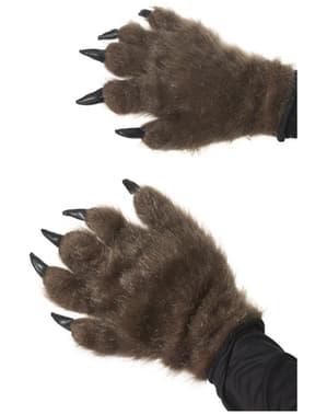 Mãos de monstro peludo castanho