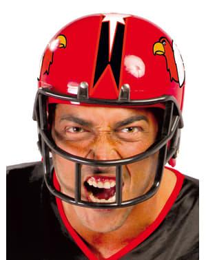 Czerwony kask zawodnika futbolu amerykańskiego dla dorosłych