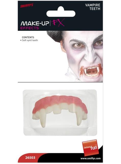 Dentadura con colmillos afilados