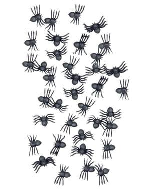 Pussillinen pieniä Halloween-hämähäkkejä