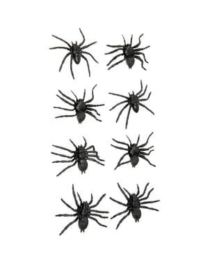 Pose med Halloween edderkopper