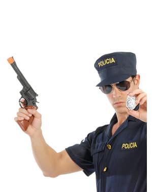 Pistola Magnum y chapa