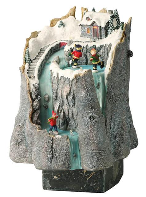 Pueblo navideño de casa en la montaña con luz y movimiento