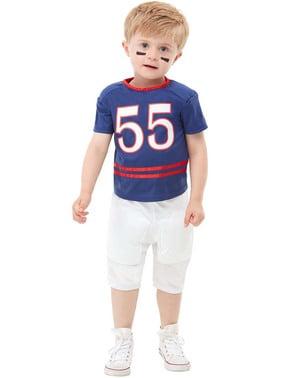 美式足球服装的孩子们