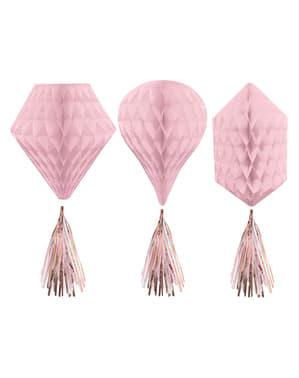 Pinkki kennopaperinen riippuva somiste ja tupsuja lukuisissa muodoissa
