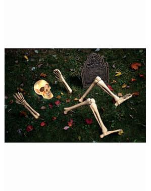 Dekorationsfigur skelett som reser sig ifrån graven