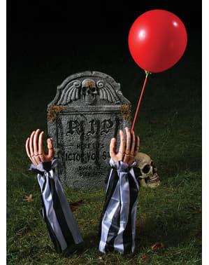 Dekorationsfigur med clownarmar ifrån graven