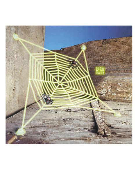 Teia fluorescente com aranhas