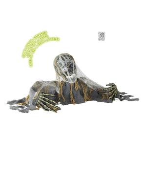 Szkielet zombie wychodzący z ziemi