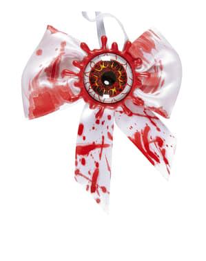Dressløyfe med blodig øye