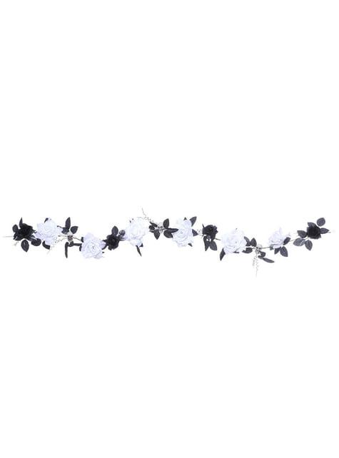 Guirnalda de calaveras y rosas blancas con luz cambiante