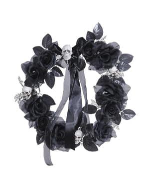 Krone med dødningehoveder og sorte roser med skiftende lys