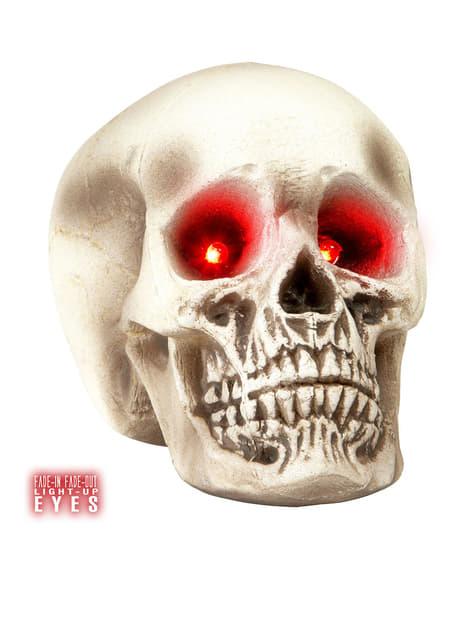 Caveira com olhos vermelhos luminosos