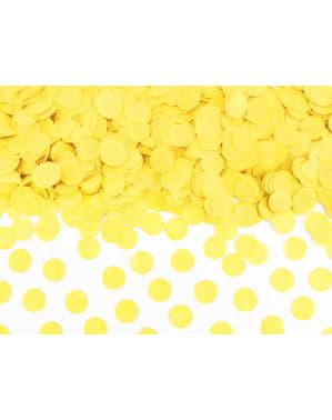 Confetes redondos amarelos de papel para mesa