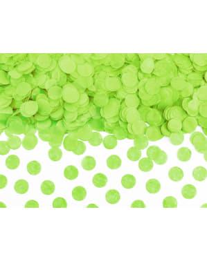 Confetes redondos em verde claro de papel para mesa