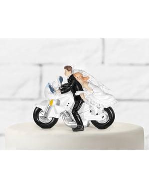 Bruidstaart figuur met bruid en bruidegom op motor