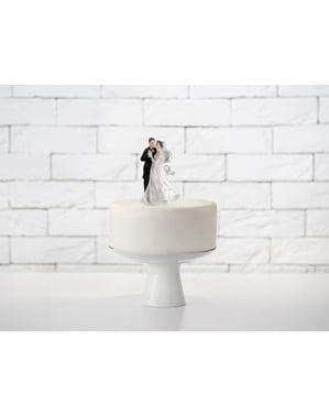 नाचते हुए दूल्हे और दुल्हन के साथ वेडिंग केक का आंकड़ा