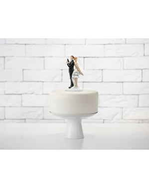 Wedding cake figure with secret agent bride and groom