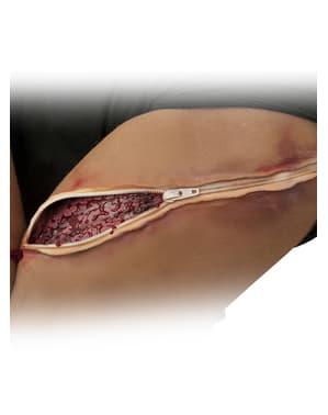 Prótesis de brazo desgarrada con cremallera