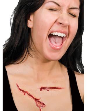 Prótesis de látex arañazos sangrientos