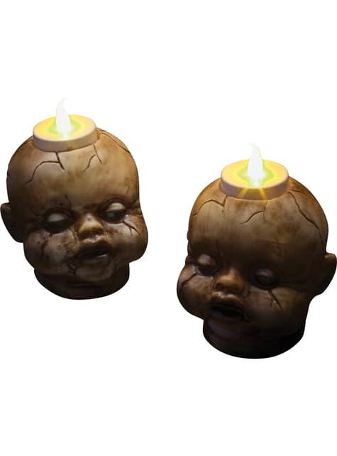 2 Aufgerissene Puppenköpfe mit Kerzen (7 cm)