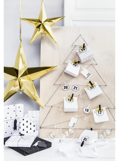 Hanging paper star in gold measuring 70 cm