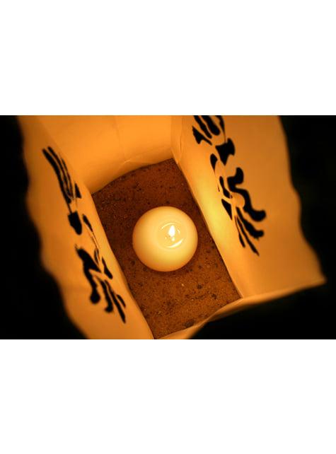 10 kynttiläkassia stanssatuilla kyyhkysillä