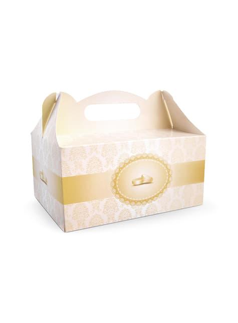 10 kultaista kakkulaatikkoa hääsormuksilla