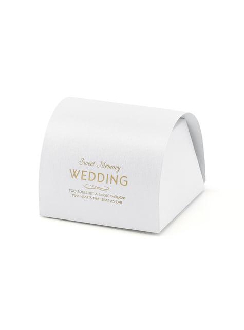 10 valkoista lahjalaatikkoa kultaisella