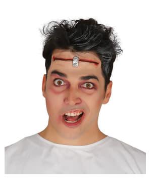 Голова вирізала шрам