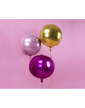 Foil balloon in the shape of a ball in pale pink