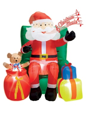 Inflatable santa claus sitting on giant armchair