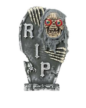 Piatră funerară schelet cu ochi colorați