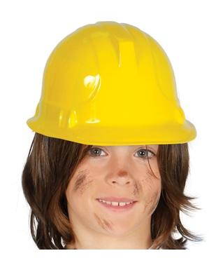 Keltainen rakennusmiehen kypärä lapselle