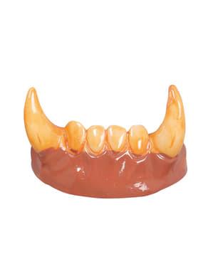 Aikuisten kellastuneet ihmissuden hampaat