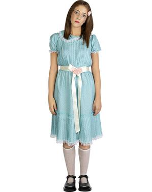 Meisje uit het glanzende kostuum voor vrouwen