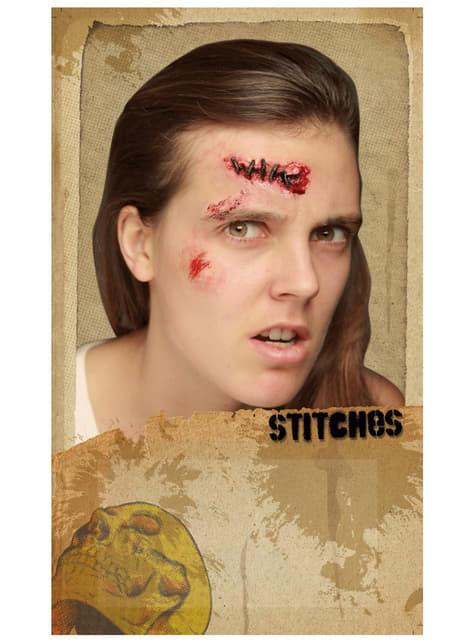 Prótesis de látex herida suturada