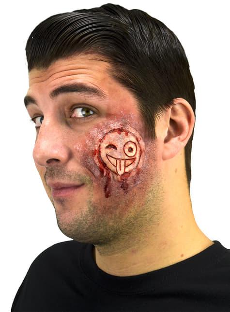 Prótesis grabado en piel emoji sangriento