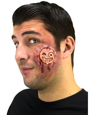 Proteza wycięty na twarzy emotikon