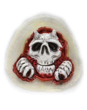 Totenkopf kommt aus der Haut Prothese