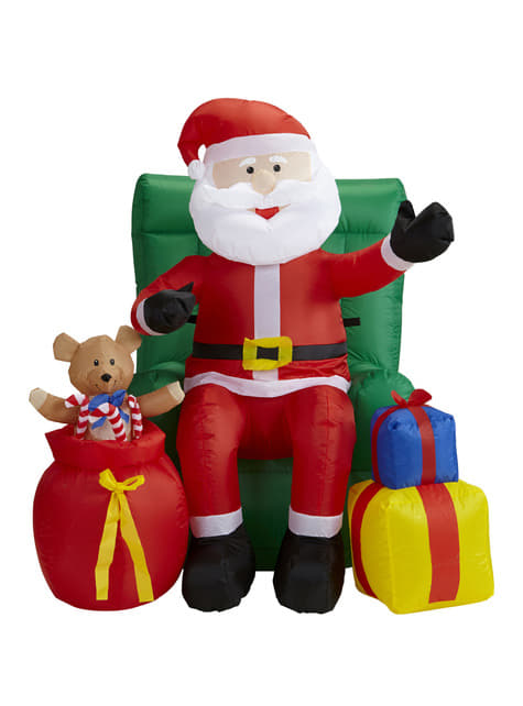 Figura decorativa de Papá Noel sentado sobre sillón gigante