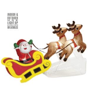 Şişme ren geyiği ile Noel Baba dekorasyon