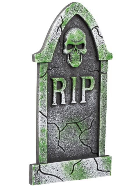 Tumba RIP verde e cinzenta com esqueleto